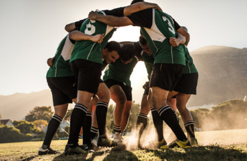 team members huddle before a big game